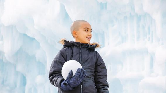 wish kid Shore holds a giant snowball