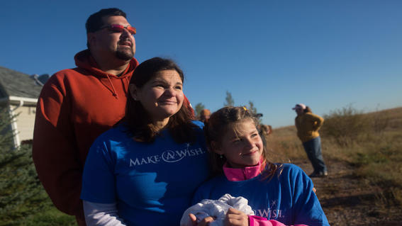 Wish kid Teagan and her parents
