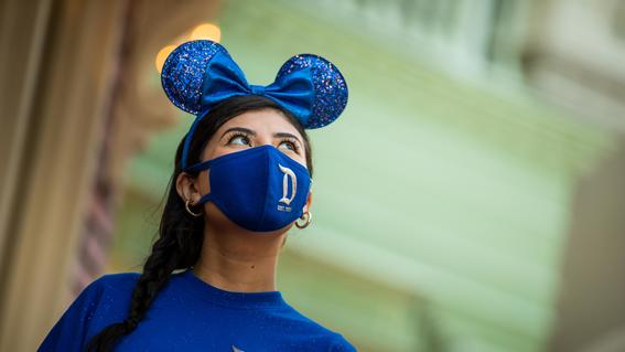 Woman wearing Wishes Come True Blue Collection ears, mask and shirt