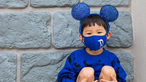 Boy wearing Wishes Come True Blue Collection ears, mask and shirt