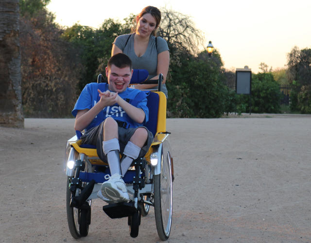 Brendan and his mother Natalie on his adaptive bike