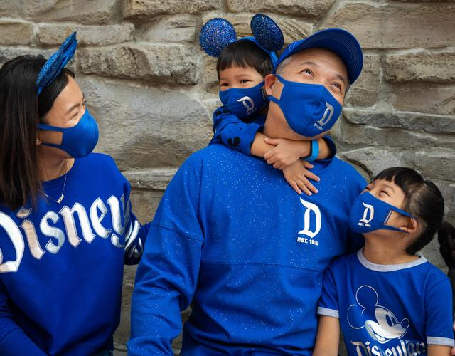 Family wearing Disney Parks' Wishes Come True Blue Color Collection
