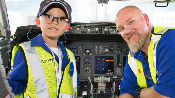 wish kid Randy in a Southwest Airlines cockpit