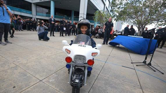 Liam on his motorcycle in front of police station