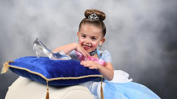 Caleigh poses with Cinderella's glass slipper.