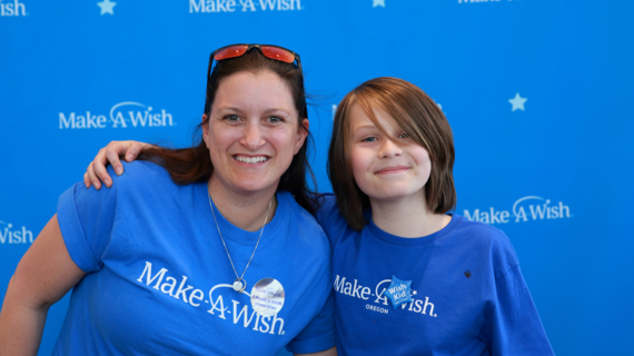 Danton celebrates his wish coming true with Volunteer Wish Granter Megan