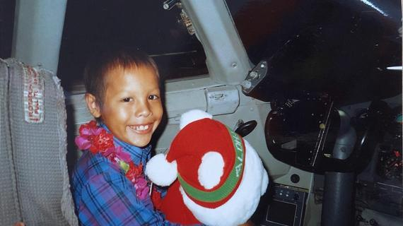 1st wish recipient, John, sits in the airplane cockpit