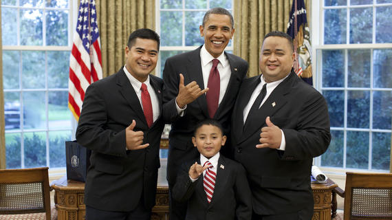 "Juan, his dad, and the Saipan congressional delegate ""shaka"" with President Obama"