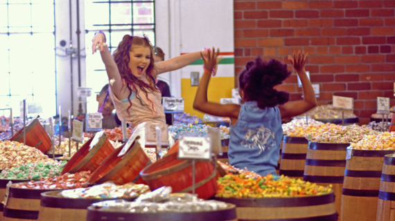 Wish Kid Makayla dances during her music video shoot with Wish Kid Jenna at a candy store