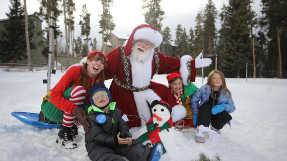 Santa with a wish family in the snow