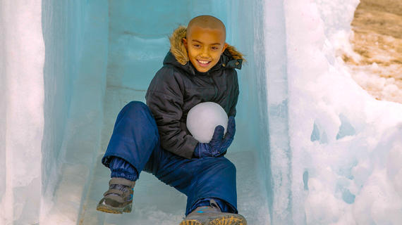Wish kid Shore in a small ice cave with a giant snowball