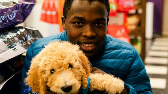 Kayleb holds his puppy Kevin