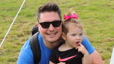 Volunteer Brian with his daughter at Walk for Wishes