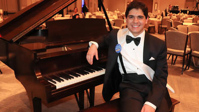 Hunter with his brand new grand piano at the 35th Anniversary Gala
