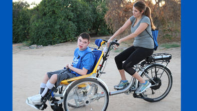 Brendan and his mom Natalie on his new adaptive bike