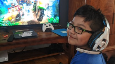 Wish Kid Daniel playing Xbox