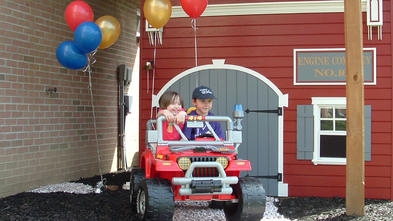 Six-year-old Ezra takes his Fire Rescue Jeep® for a spin around the block.