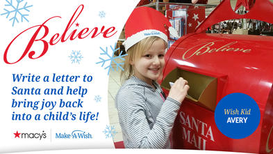 Avery puts her letter to Santa in the red Macy's mailbox.