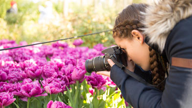 Wish kid Neeley photographing tulips in Amsterdam