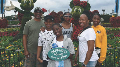 Michael and his family at Walt Disney World