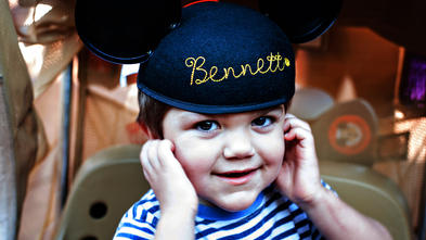 Bennett smiling in Mickey Mouse hat