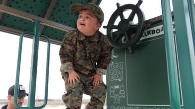 Wish kid Zach explores his military themed playset