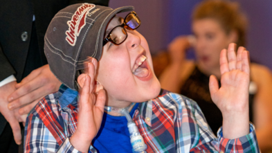 Wish kid Cole laughs during the story of his wish experience at Wish Ball 2020