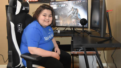 Wish kid Bryson enjoys a new computer gaming center.
