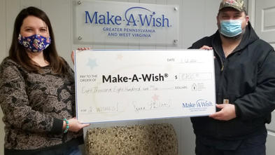 Volunteers Diana and Doug Blood generously present their donation from their Cans for Wishes fundraising event.