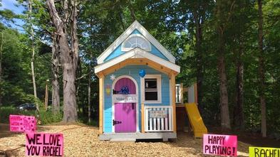 Rachel's new playhouse is decorated for her wish day.
