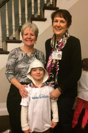Wish kid Jared with his volunteers Jeanne and Claire.