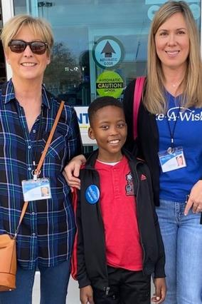 Kiddo with two volunteers